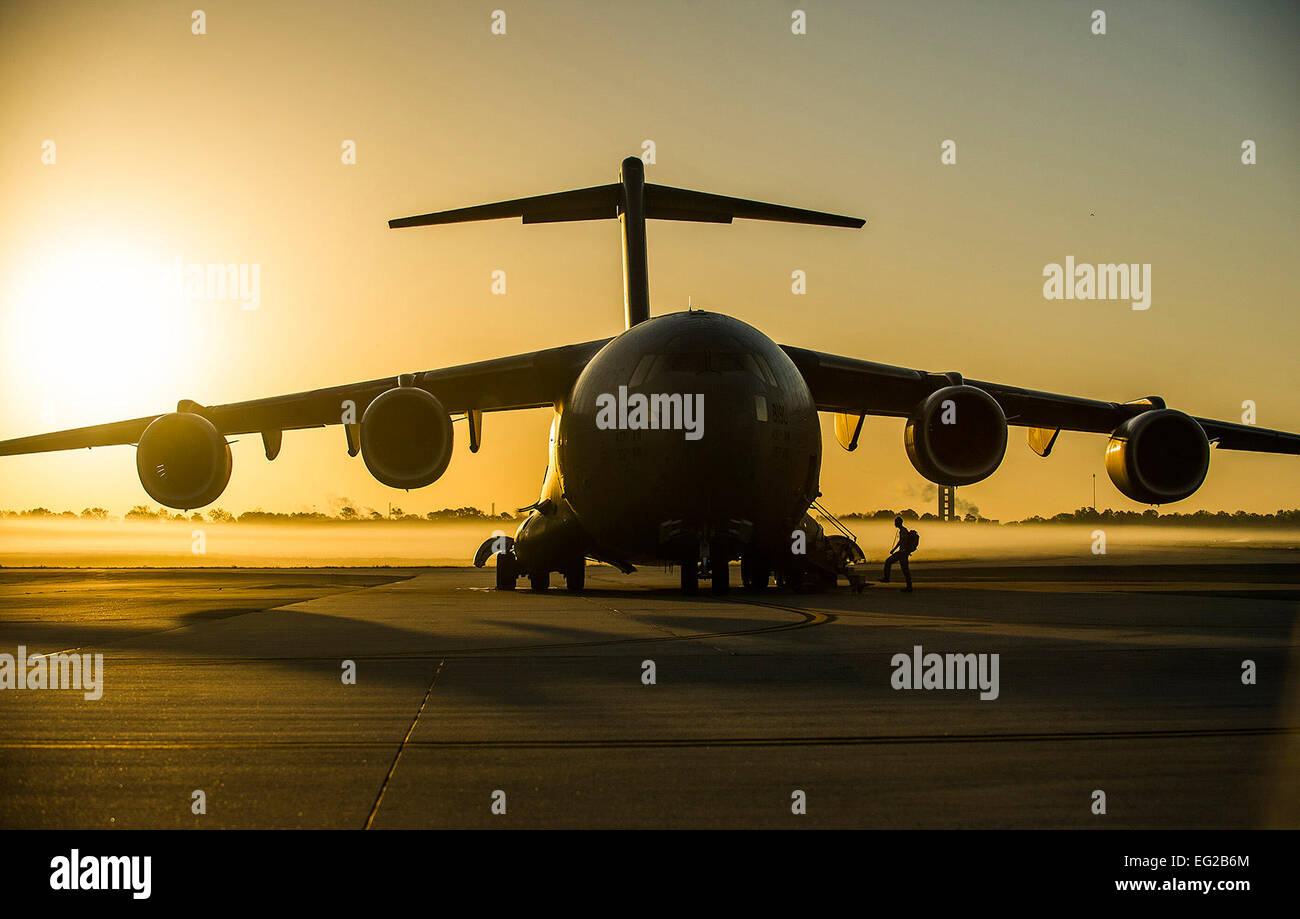 An aircrew member from the 437th Airlift Wing boards a C-17 Globemaster III during a training exercise April 10, Stock Photo