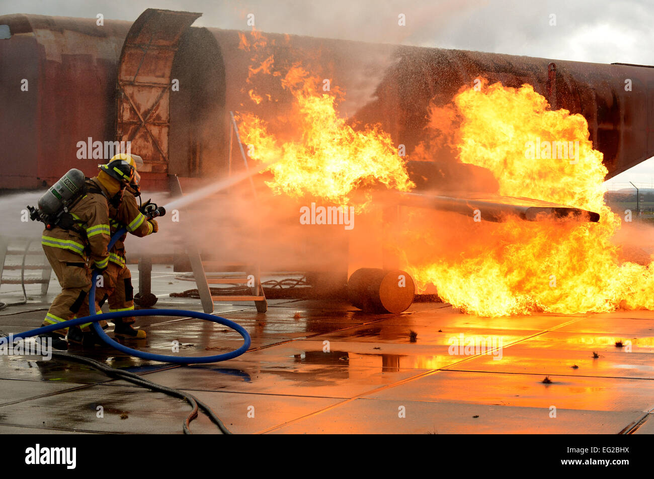 U S  Air Force firefighters suppress an engine and fuel fire