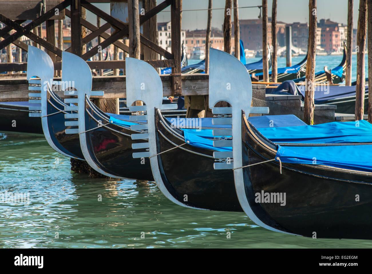 Gondolas' bows, Venice, Veneto, Italy - Stock Image