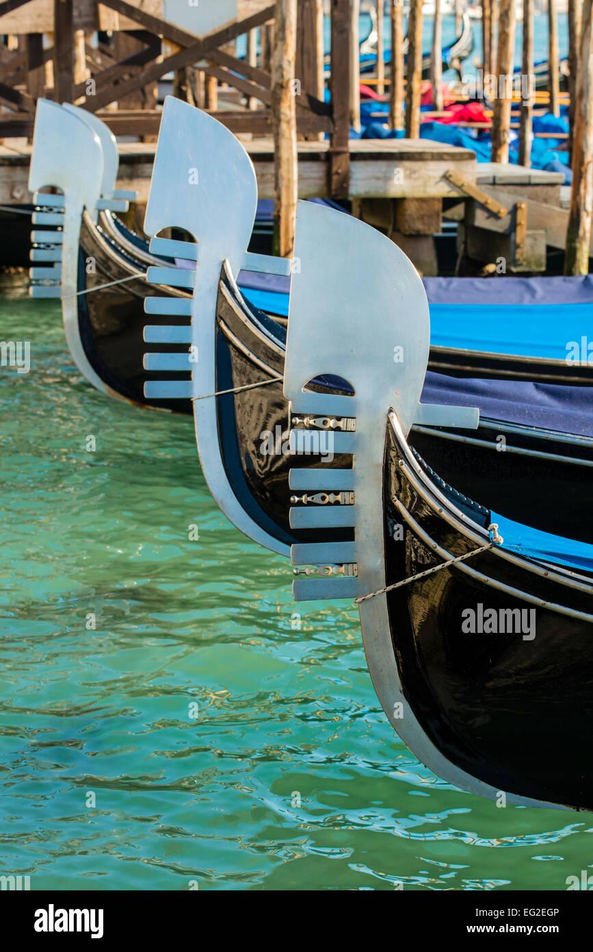 Bows of Gondolas, Venice, Veneto, Italy - Stock Image