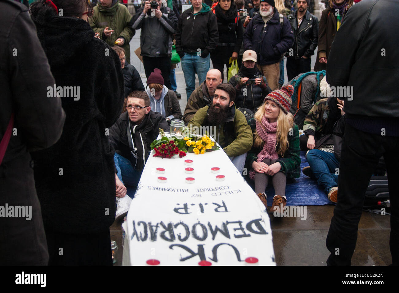 London, February 14th 2015. A few dozen activists from Occupy Democracy gather at Parliament Sqyuuare to hold a - Stock Image
