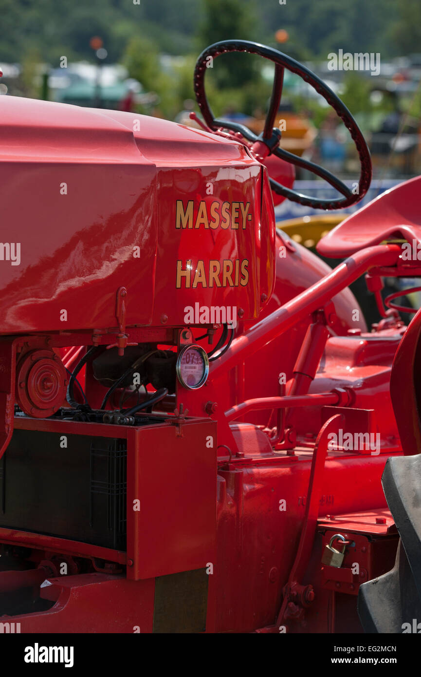 Partial close-up of old, classic, bright red Massey Harris vintage ...