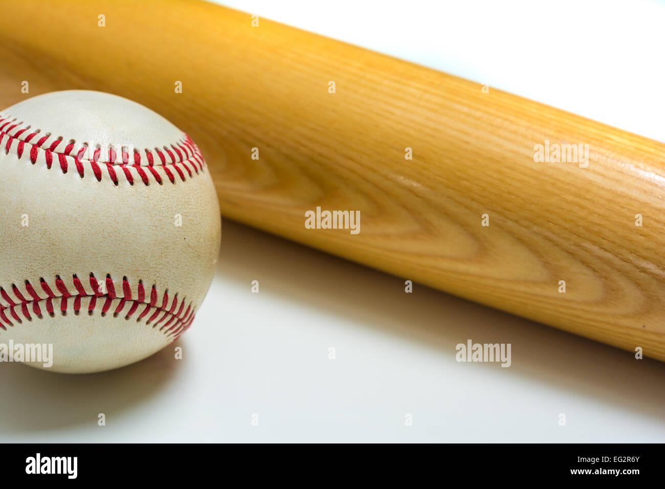 Wooden baseball bat on leather ball on white background - Stock Image