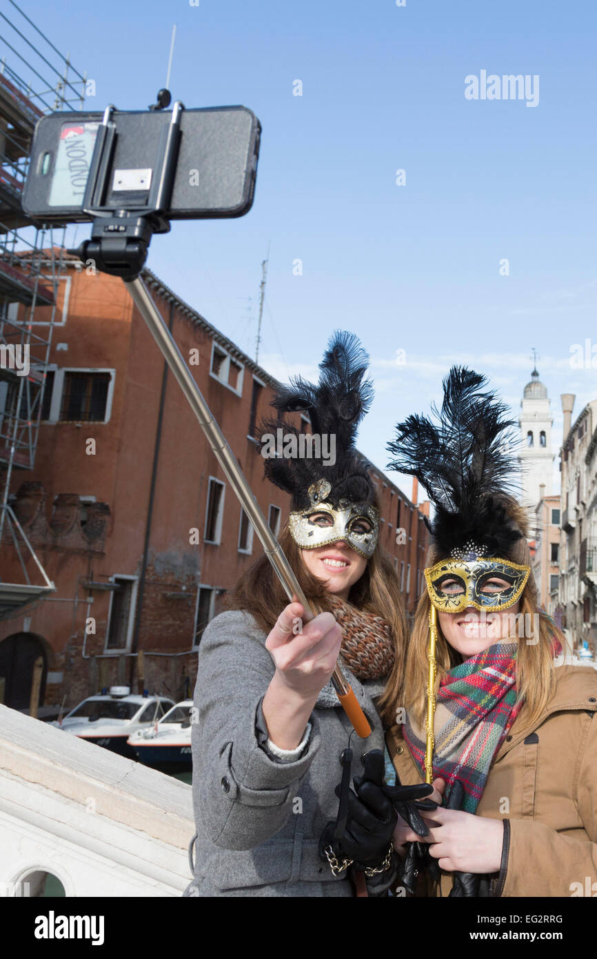 carnival at venice veneto italy two women take a selfie with the