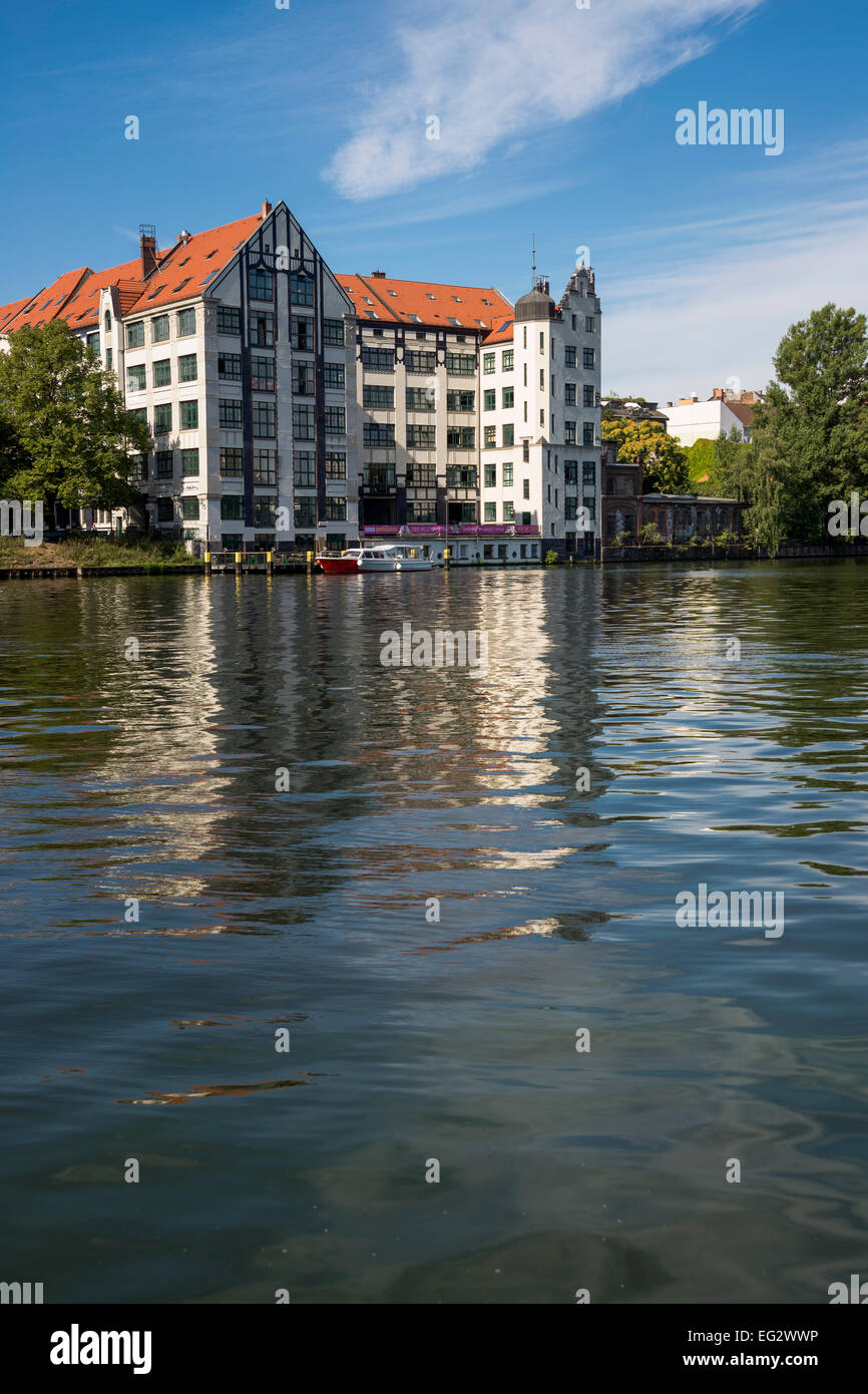 Multistory white building on the riverside of the river Spree, Berlin, Capital of Germany, Europe. - Stock Image