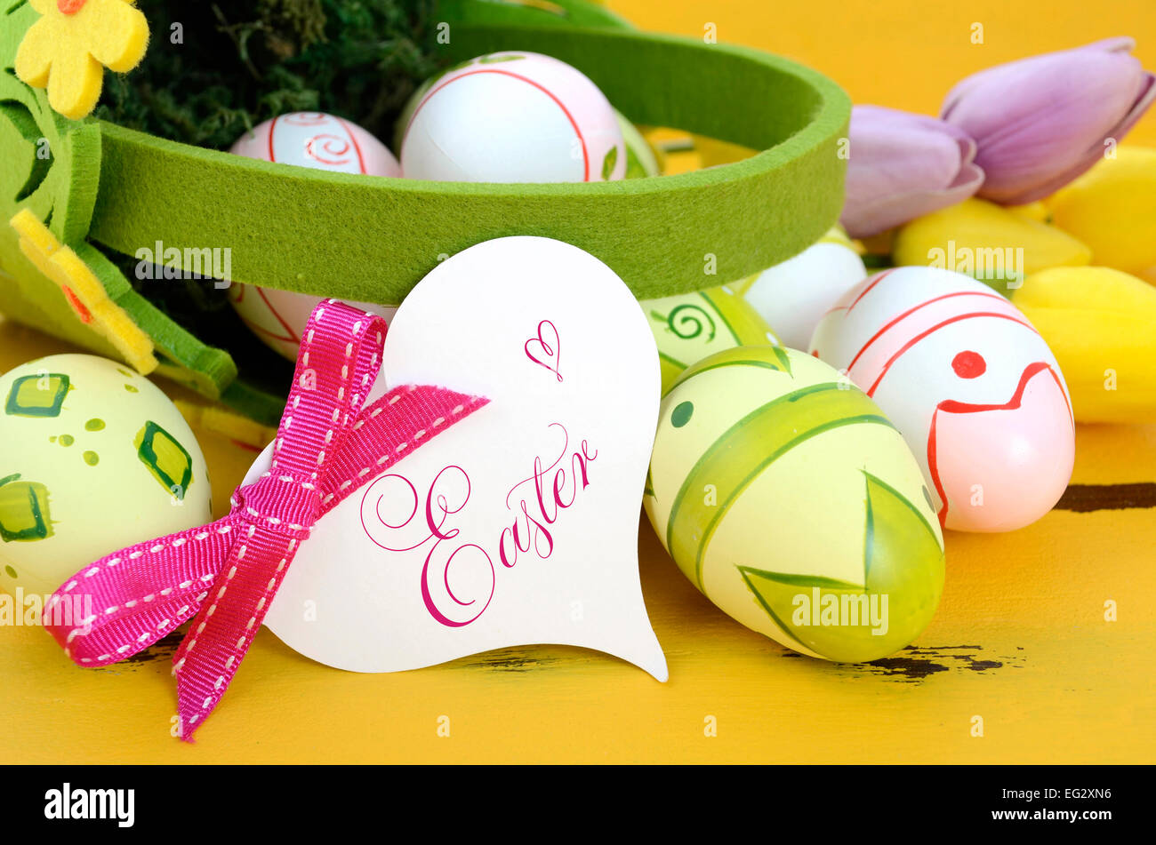 Happy Easter Green And Yellow Felt Basket Of Pink White Eggs On Rustic Vintage Wood Table