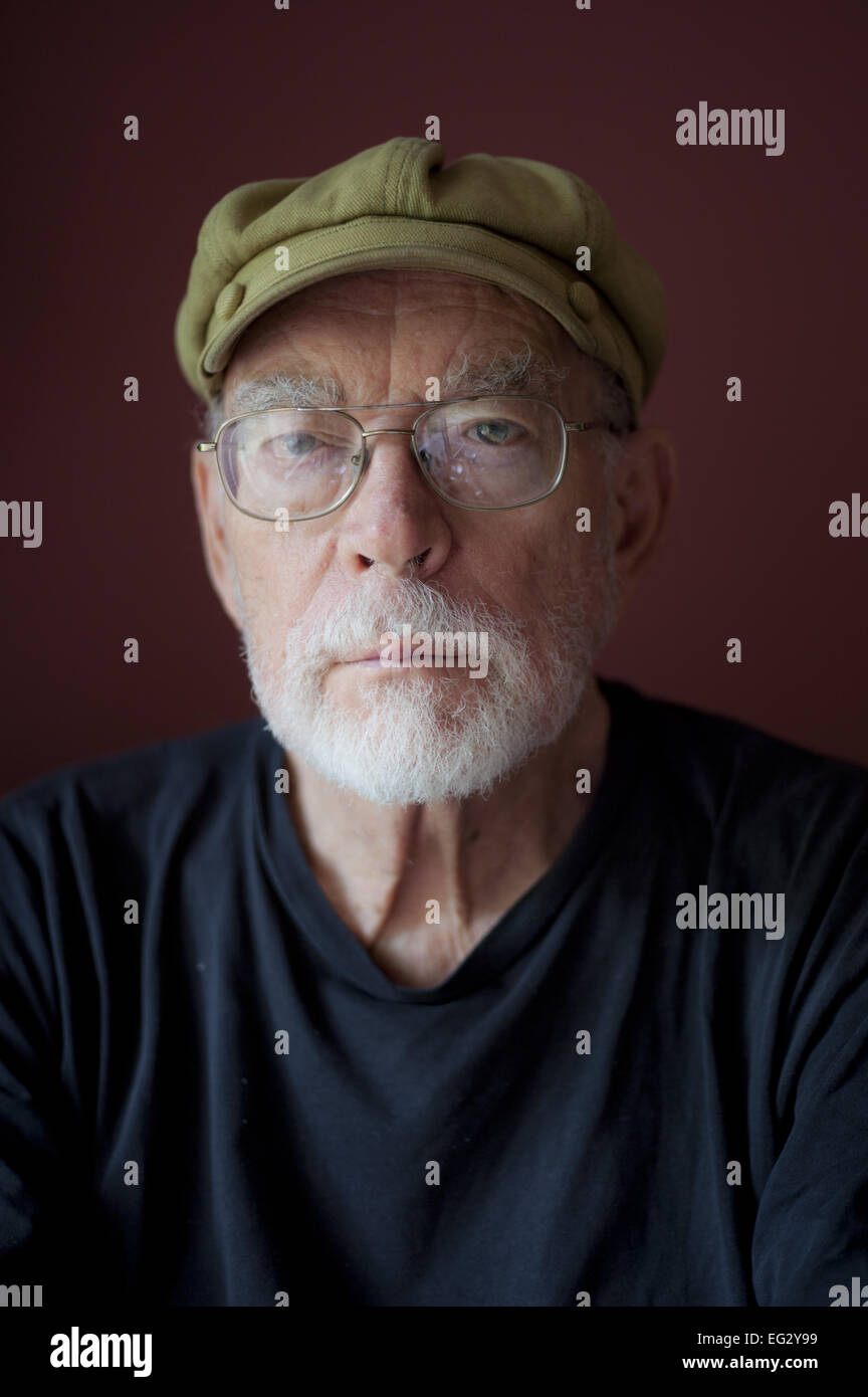 Old Man With Beard And Glasses Wearing A Mao Style Cap