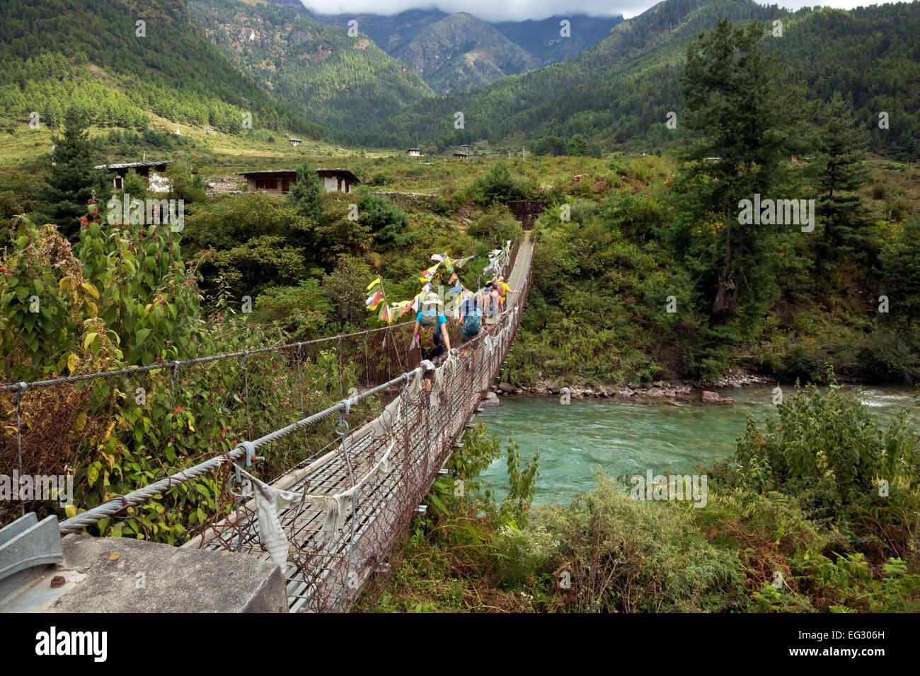 BU00143-00...BHUTAN - Trekkers crossing the Paro Chhu (river) on the first day of walking on the Jhomolhari 2 Trek. - Stock Image