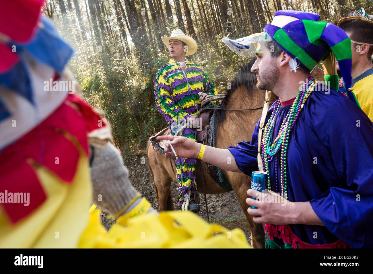 The Capitaine leads masked participants during the traditional Cajun Courir de Mardi Gras February 14, 2015 in Elton, - Stock Image