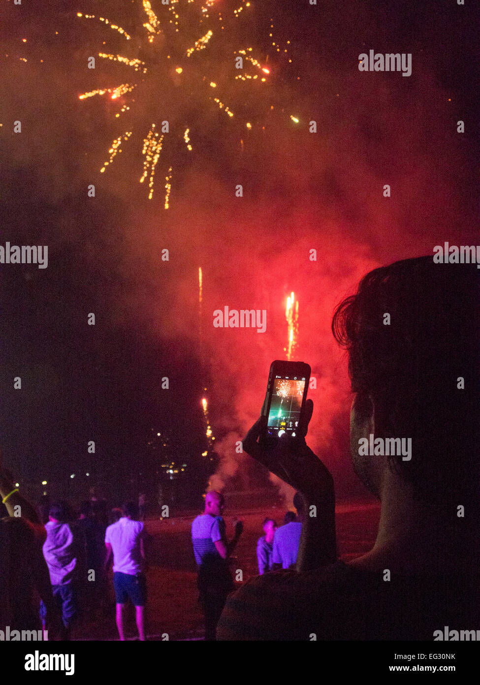 Tourists celebrate New Year's Eve 2014/2015 with fireworks in Phi Phi island in Thailand, where the 2004 Tsunami - Stock Image