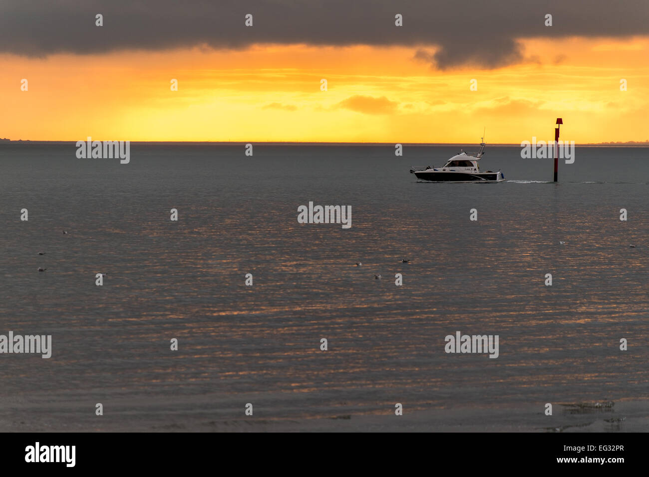 Motor cruiser on the solent during a sunset - Stock Image