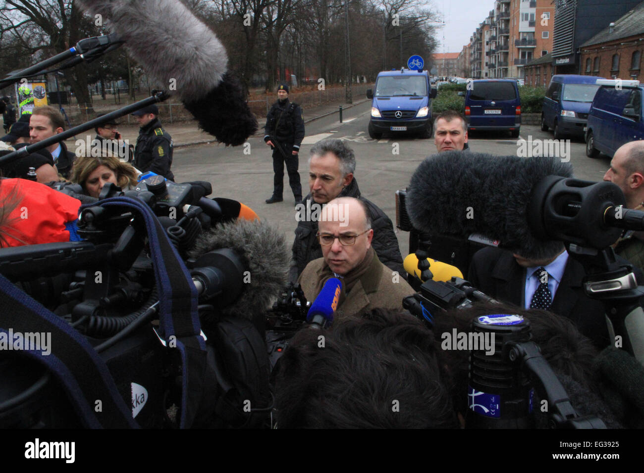 Denmark, Copenhagen. 15th Feb, 2015. French Interior Minister Bernard Cazeneuve (C) speaks during an interview in - Stock Image
