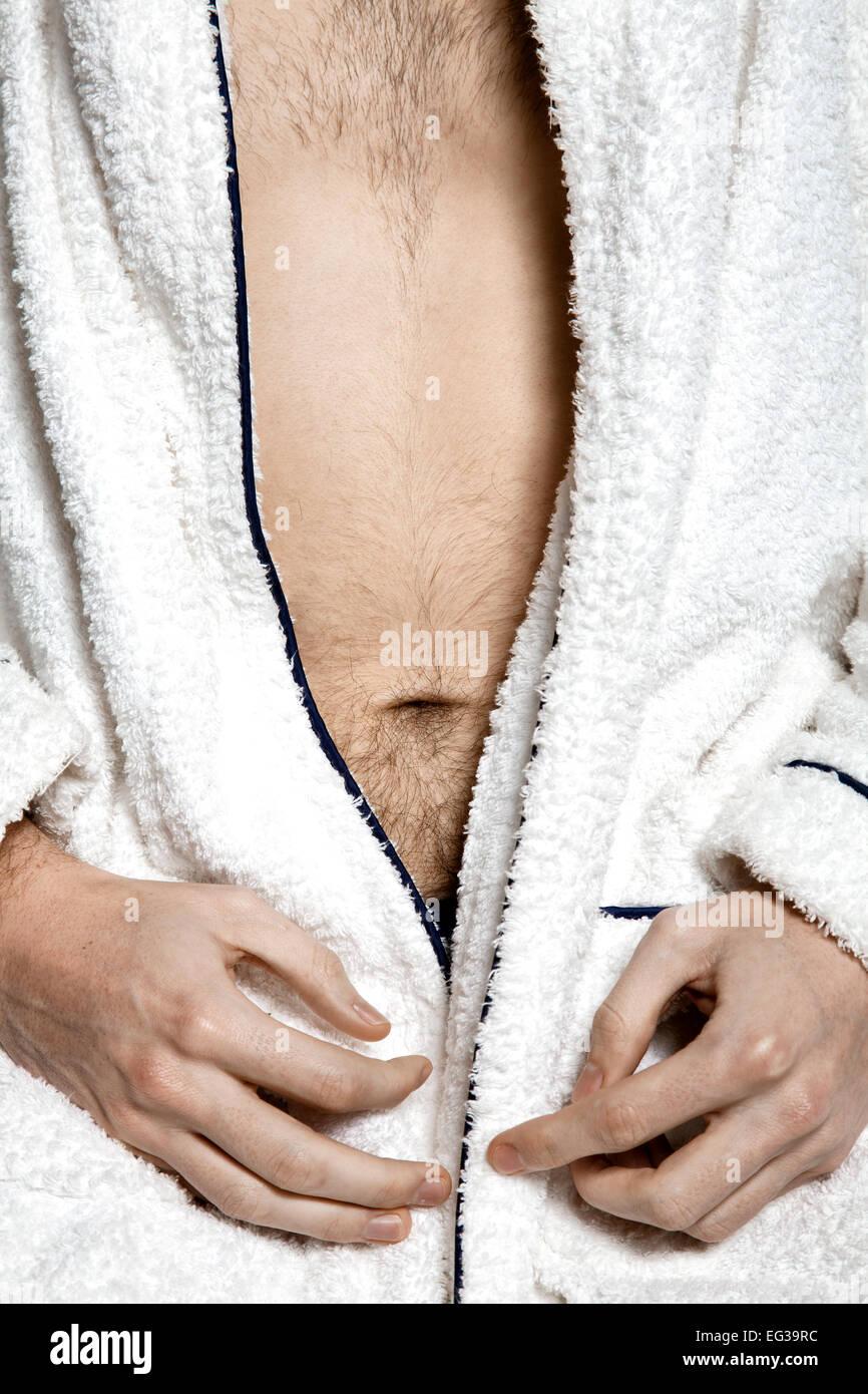 Man's Navel in Toweling Robe - Stock Image