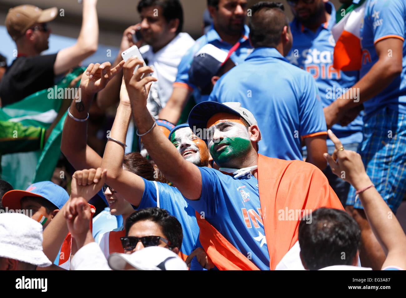 Indian cricket fans cheering Indian team during a cricket match - Stock Image