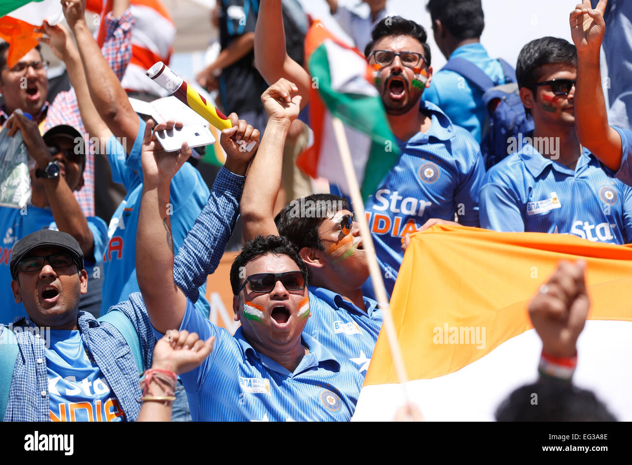 Indian cricket fans cheering the Indian team during a cricket match - Stock Image