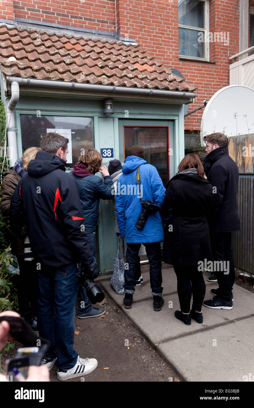 Copenhagen, Denmark, February 15, 2015: Journalists and photographers are trying to communicate via an intercom - Stock Image