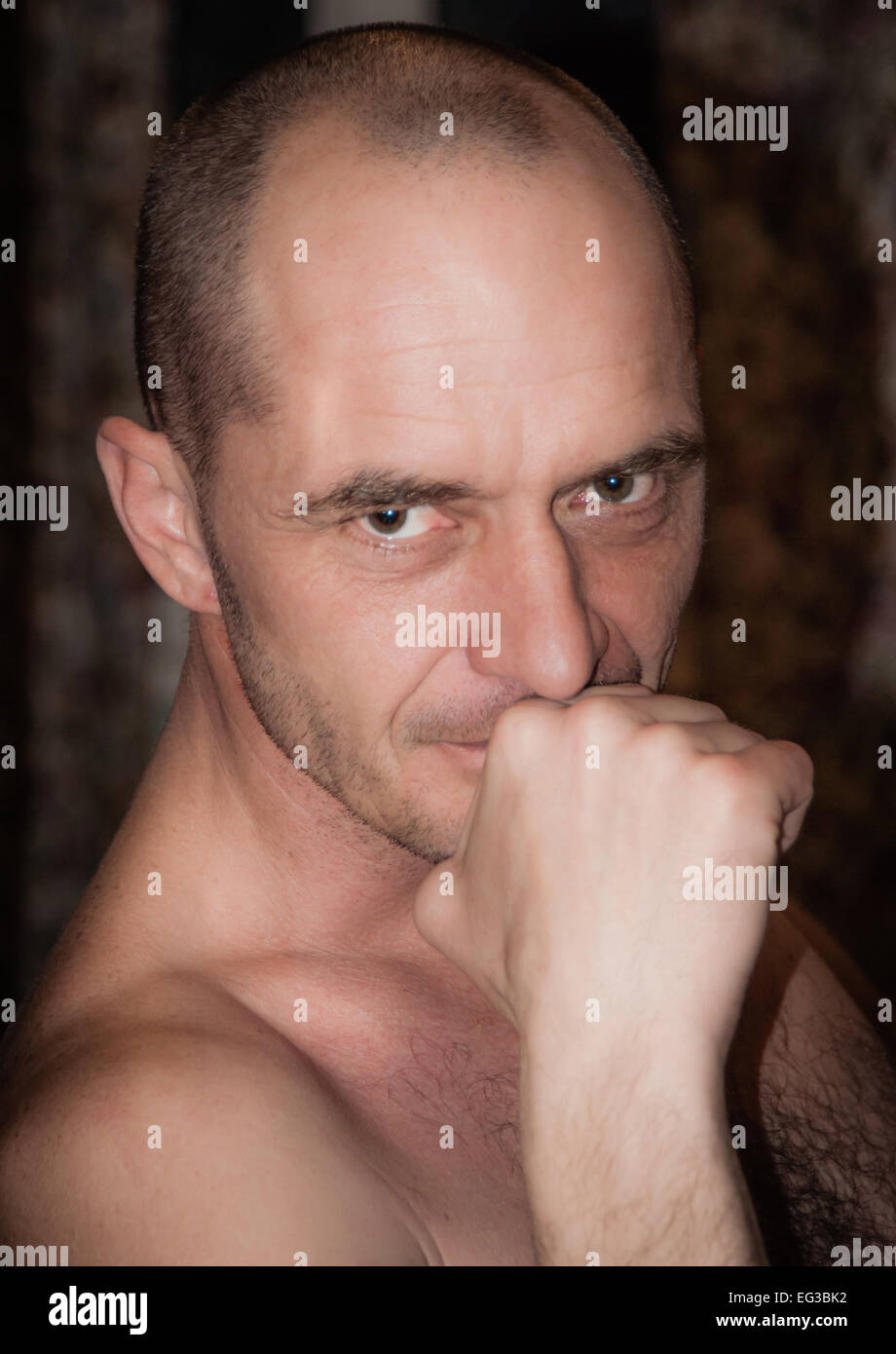 Portrait of an adult man, with a wise look - Stock Image