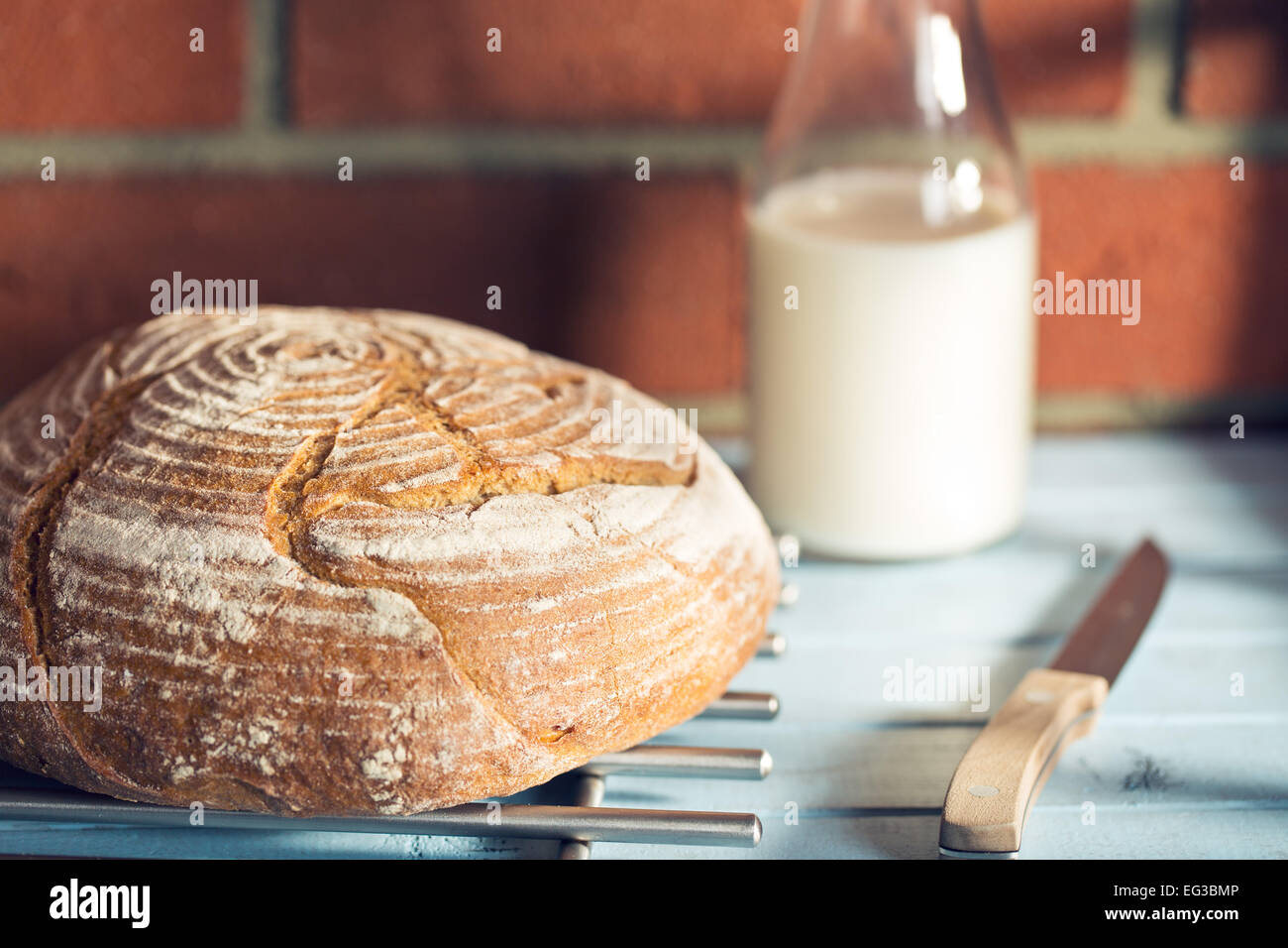 round bread on wooden table - Stock Image