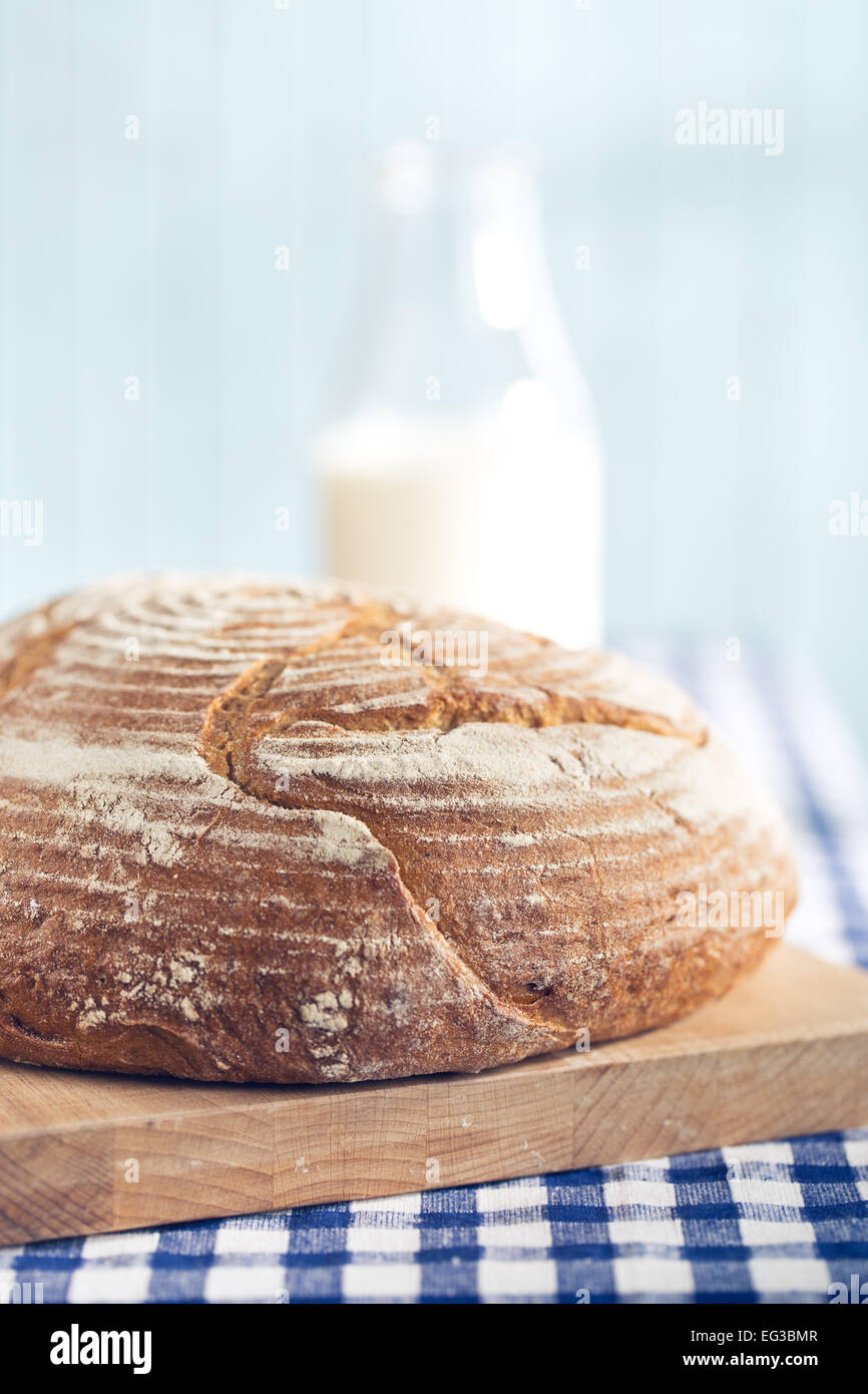 round bread on kitchen table - Stock Image