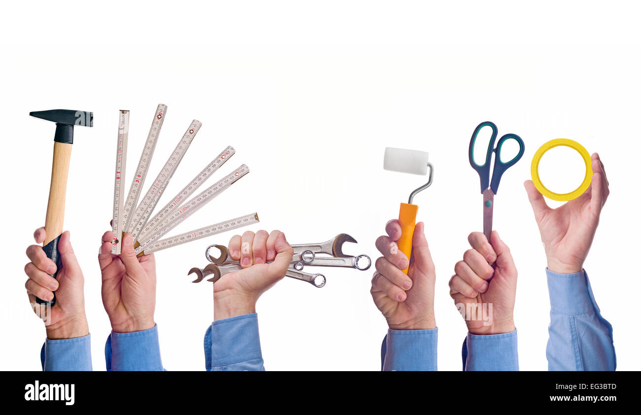 Male worker's hand holding various crafts trade tools. Part of series set of images with DIY tools for home - Stock Image