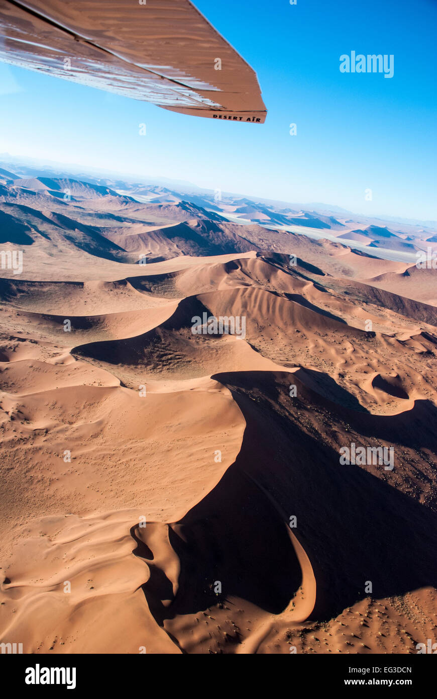 Aerial View, including the wing of small plane, over Sand Dunes in Sossusvlei, Nabib-Naukluft National Park, Namibia, - Stock Image