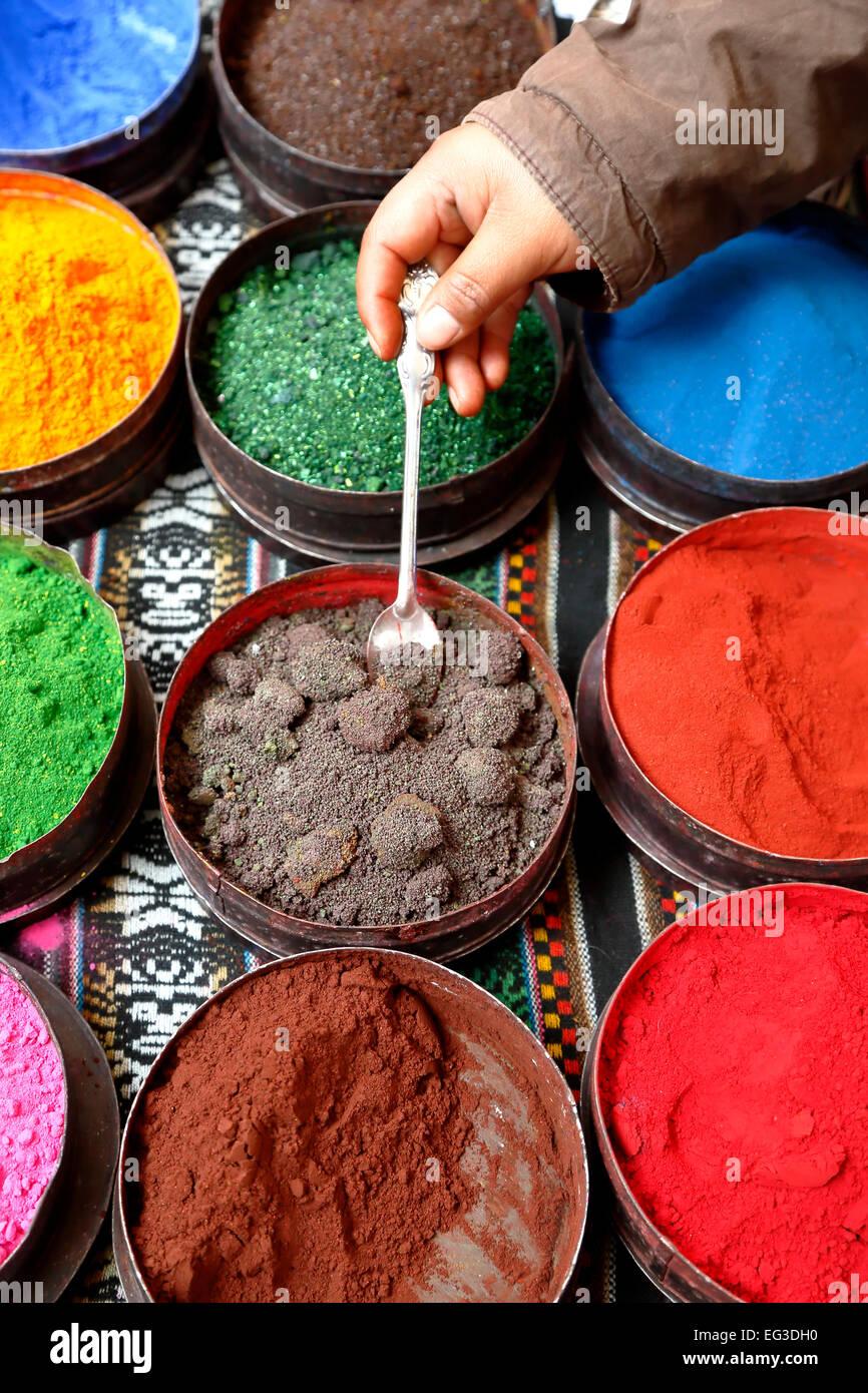 Colorful display of dyes, Pisac Sunday Market, Cusco, Peru - Stock Image