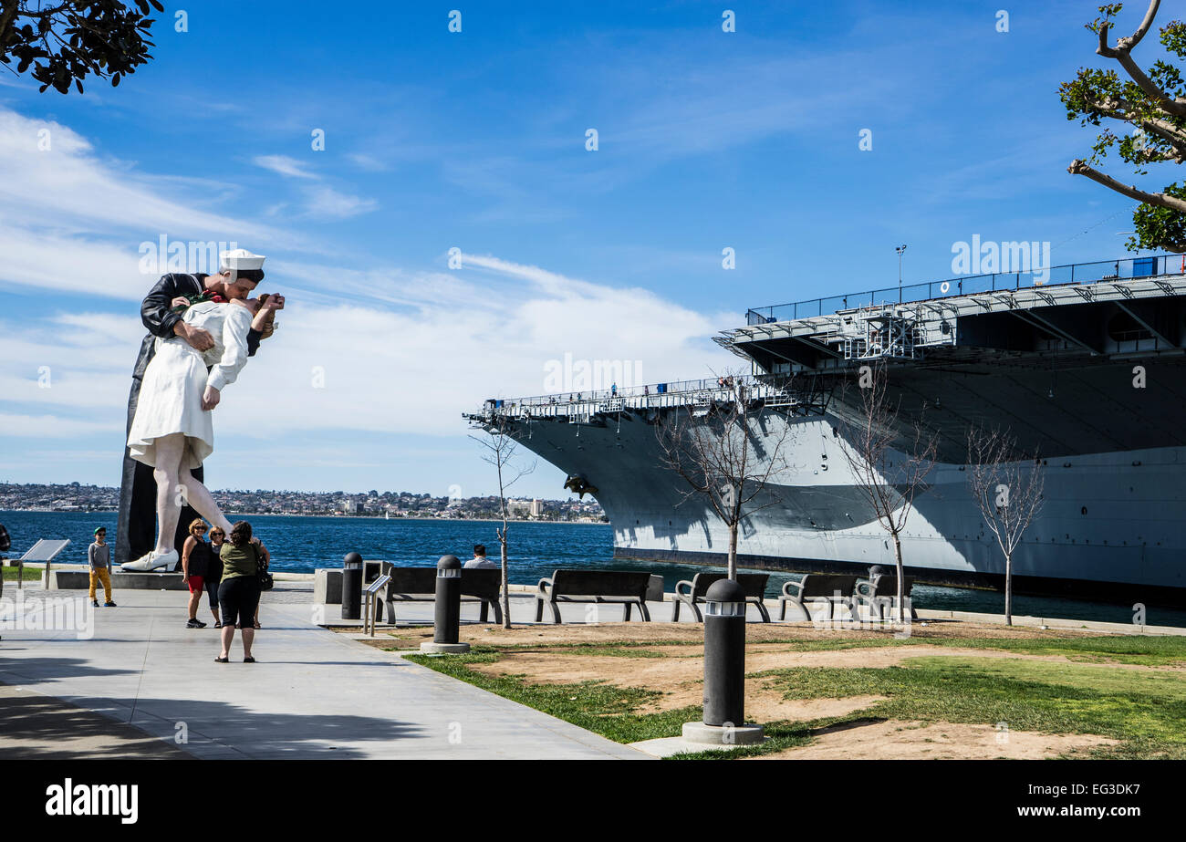 Save the kiss statue and  Midway Aircraft Carrier museum in San Diego - Stock Image