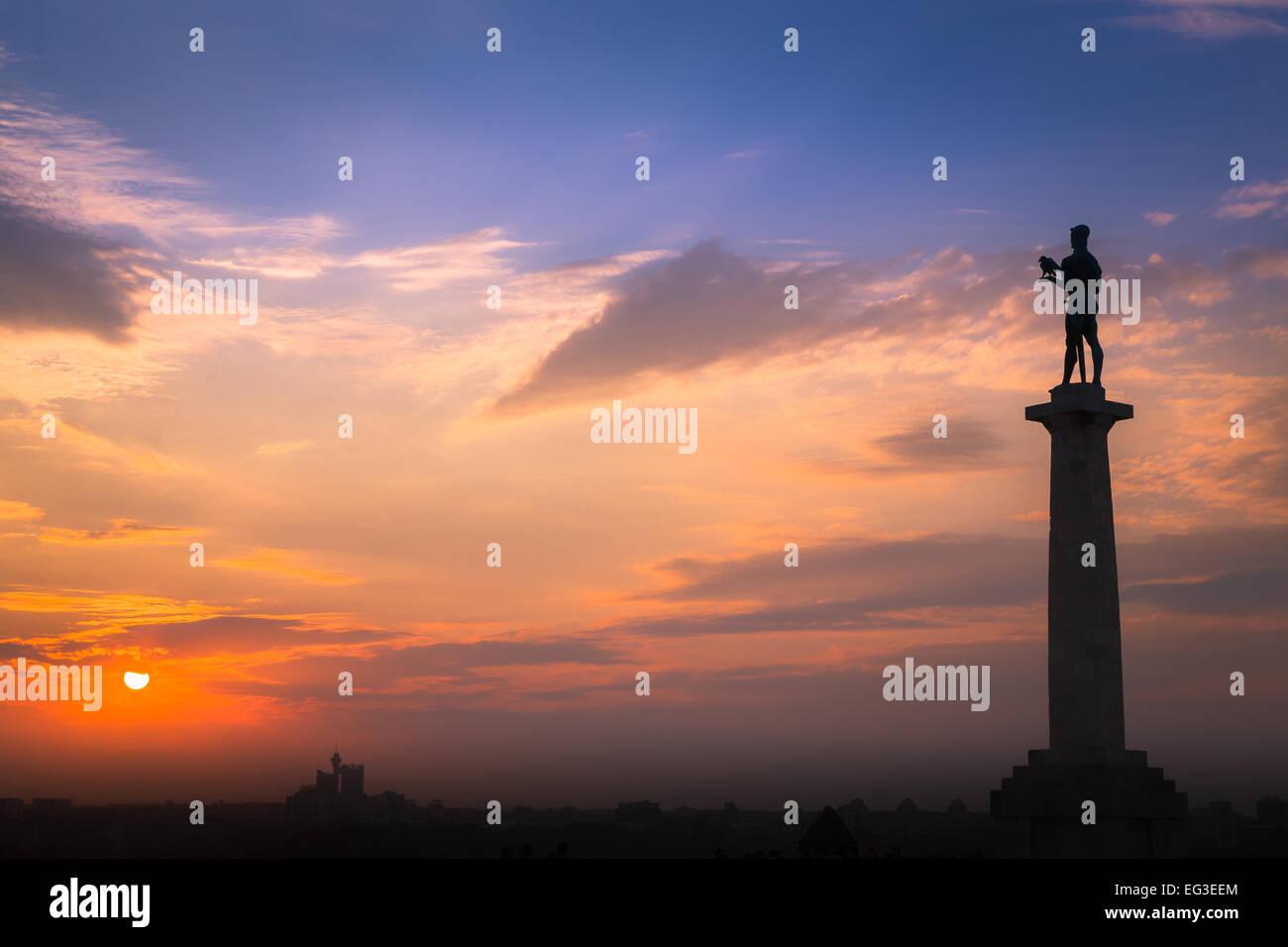 sunset at pobednik the victor monument by Ivan Meštrović in kalemegdan belgrade serbia. the statue overlooks the - Stock Image