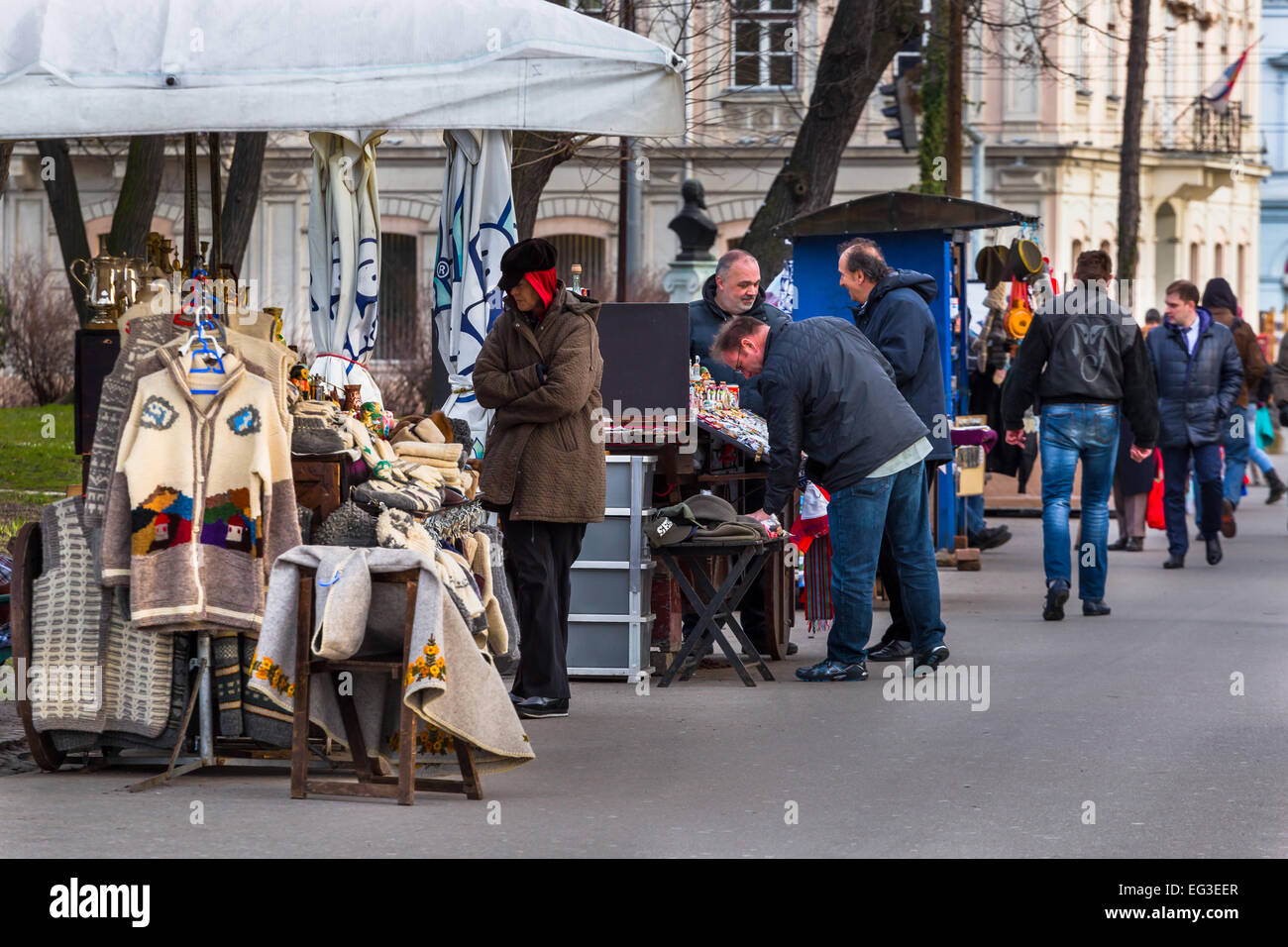 a man and woman sell traditional souvenirs from their stall at the entrance to kalemegdan in belgrade serbia - Stock Image