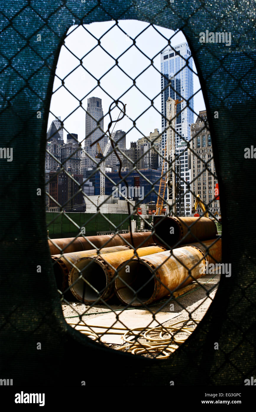 Building One World Trade Center. Looking through the fence onto reconstruction work at ground zero, Manhattan, New Stock Photo