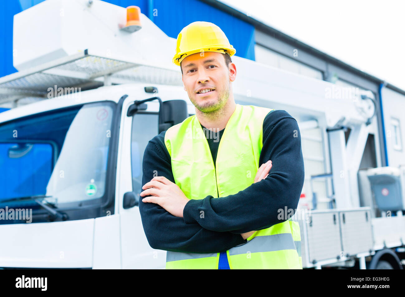 builder or driver standing in front of pallet transporter or lift