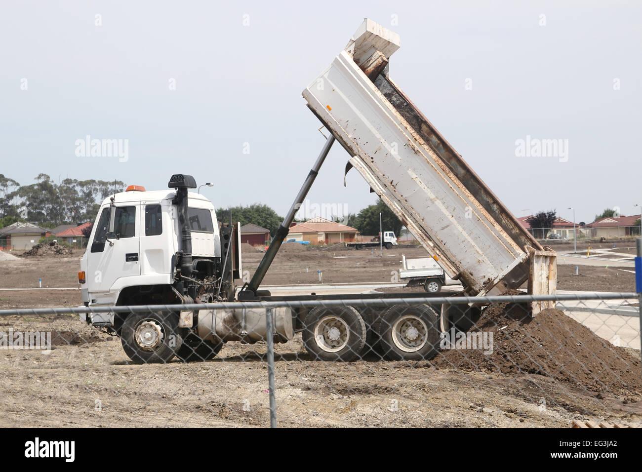 Truck dumping soil for new residential houses - Stock Image