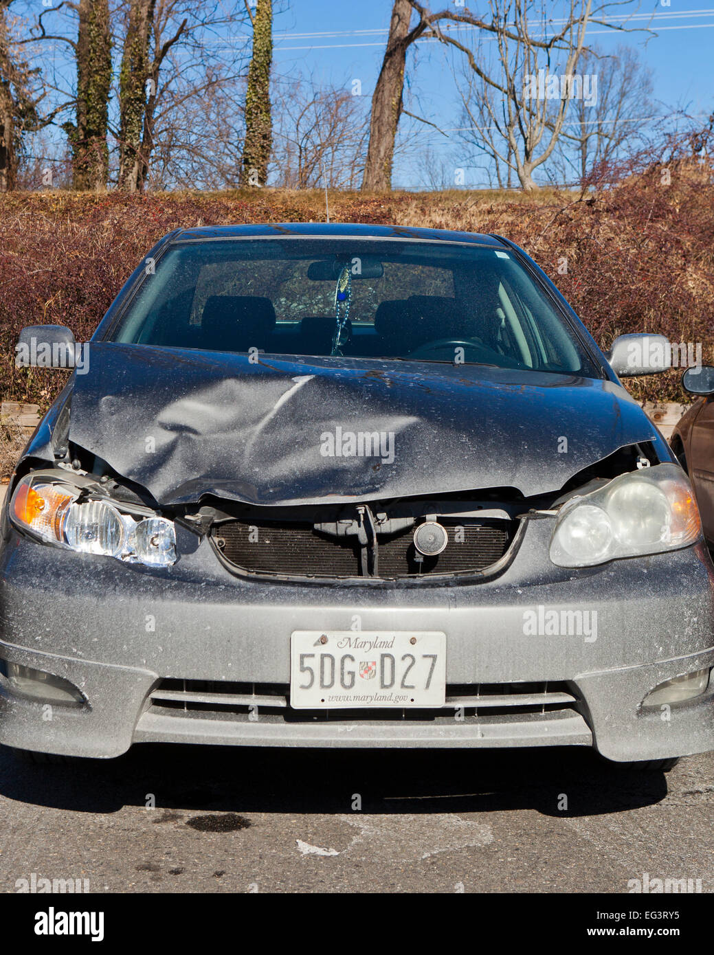 Compact car with frontal collision damage - Maryland USA - Stock Image