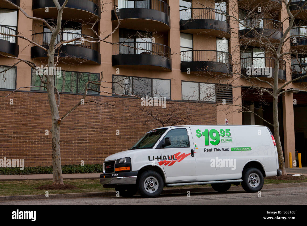 U Haul van parked outside of apartment building - USA - Stock Image