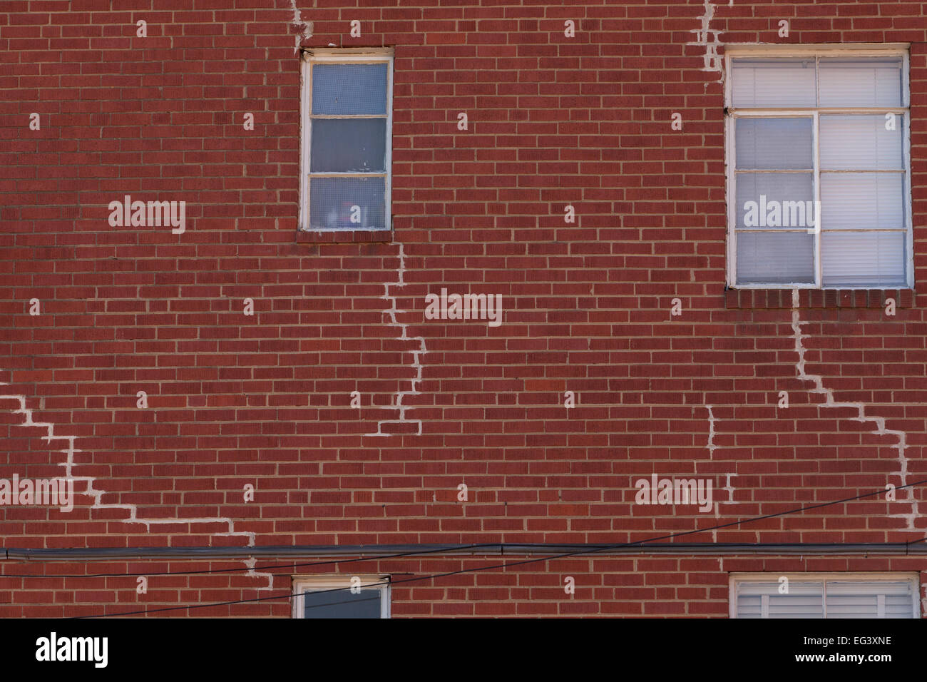 Visible crack repairs on brick exterior of building - USA - Stock Image