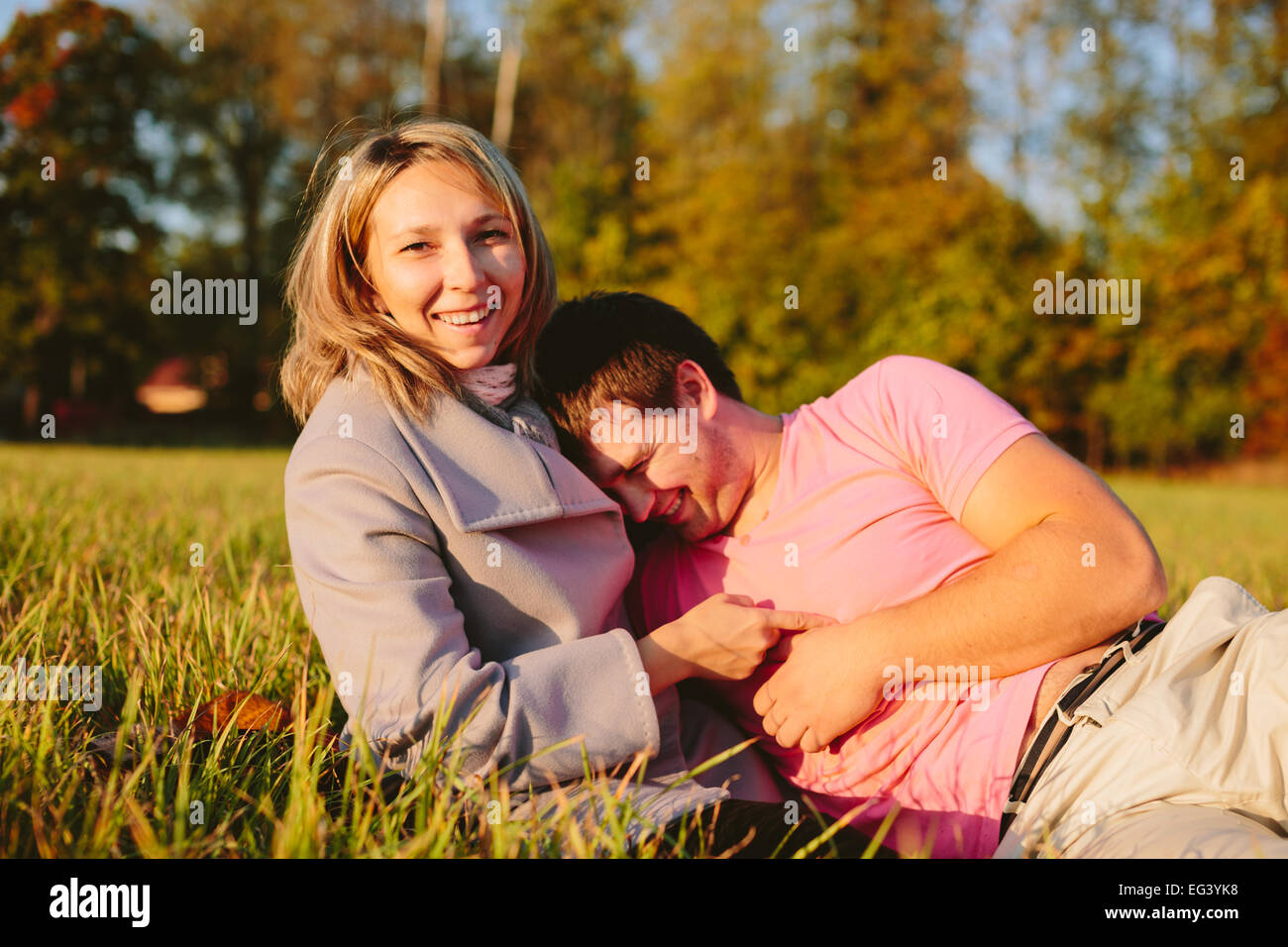 Young couple on meadow - Stock Image