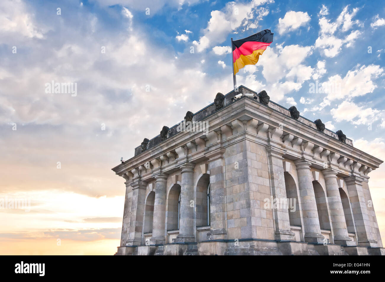 German Parliament or Bundestag with national flag in Berlin, Germany - Stock Image