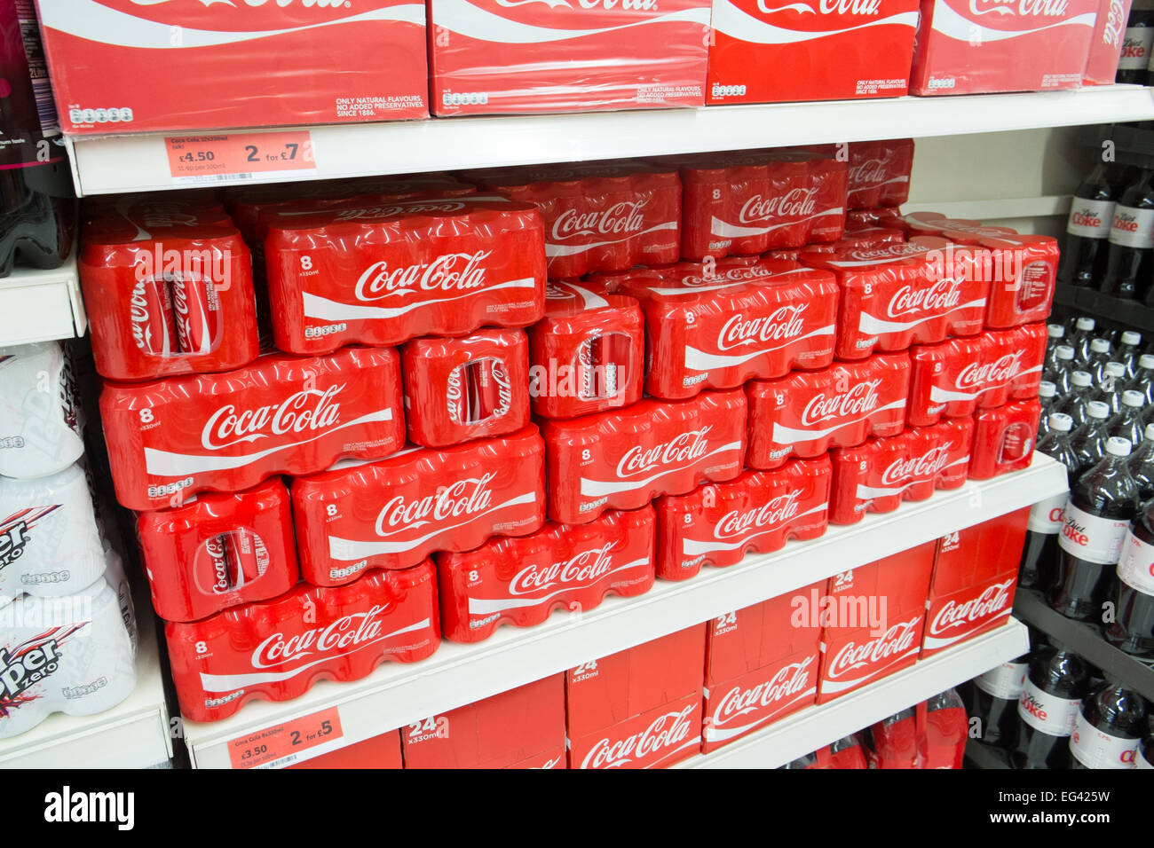 tins of coca cola for sale in a sainsburys supermarket in Derbyshire,England - Stock Image