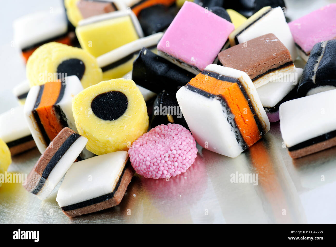 colorful liquorice candies on tray - Stock Image
