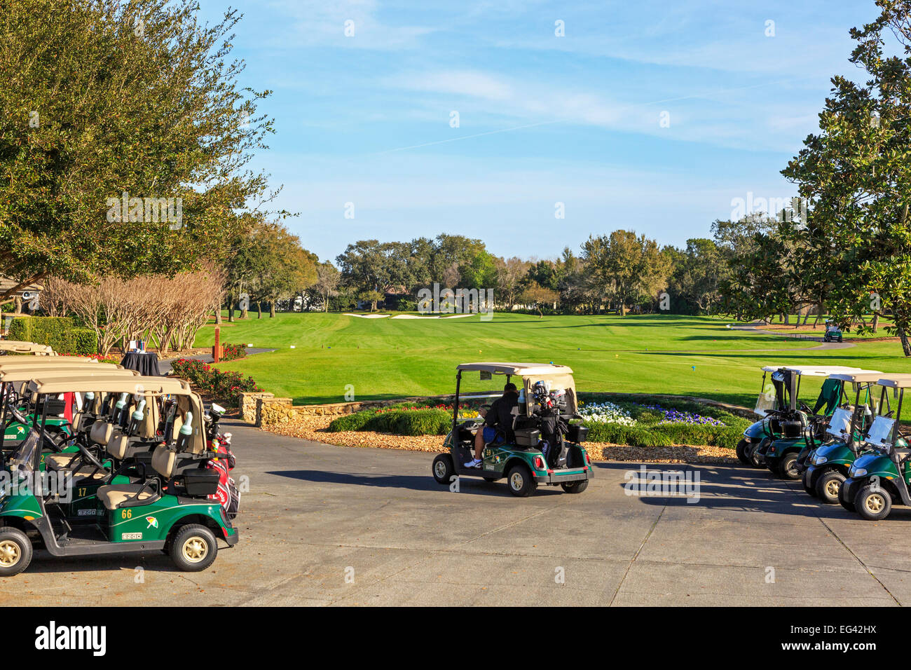 Parked golf buggies at the first tee of Arnold Palmer's Bay Hill Golf Club, Orlando Florida, America - Stock Image
