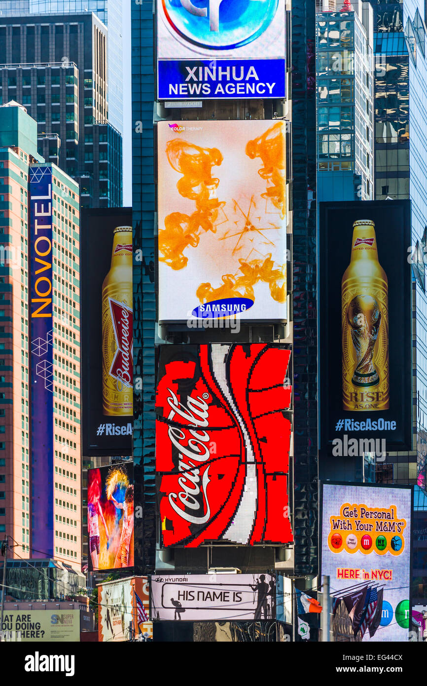 The bright lights of New York City. Advertising hoardings shine bright in the afternoon sunshine in Times Square, - Stock Image