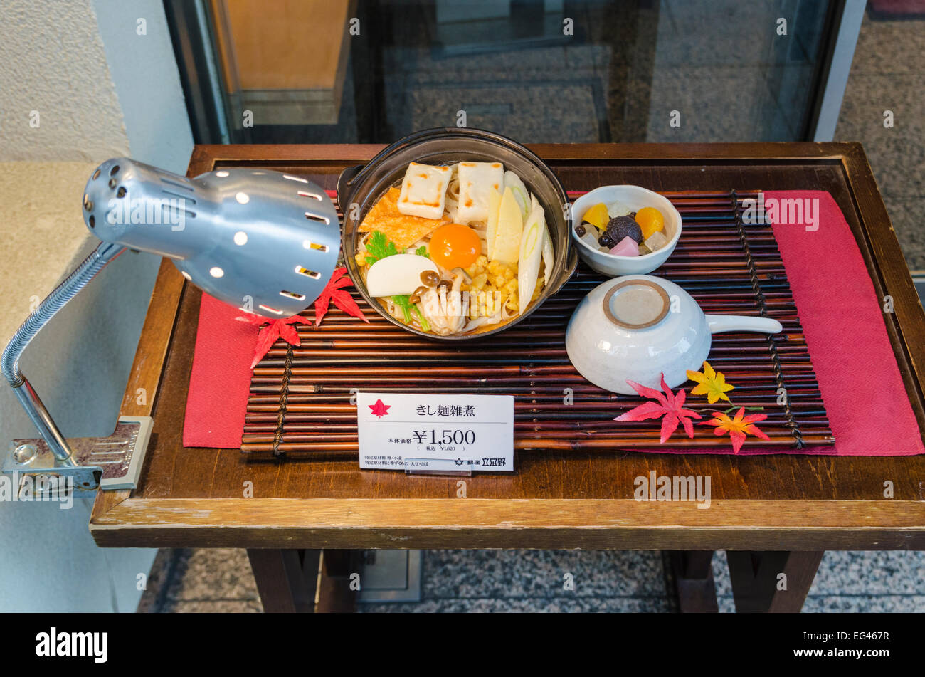Fake food replica meal in a Ginza Restaurant doorway, Ginza, Tokyo, Japan - Stock Image