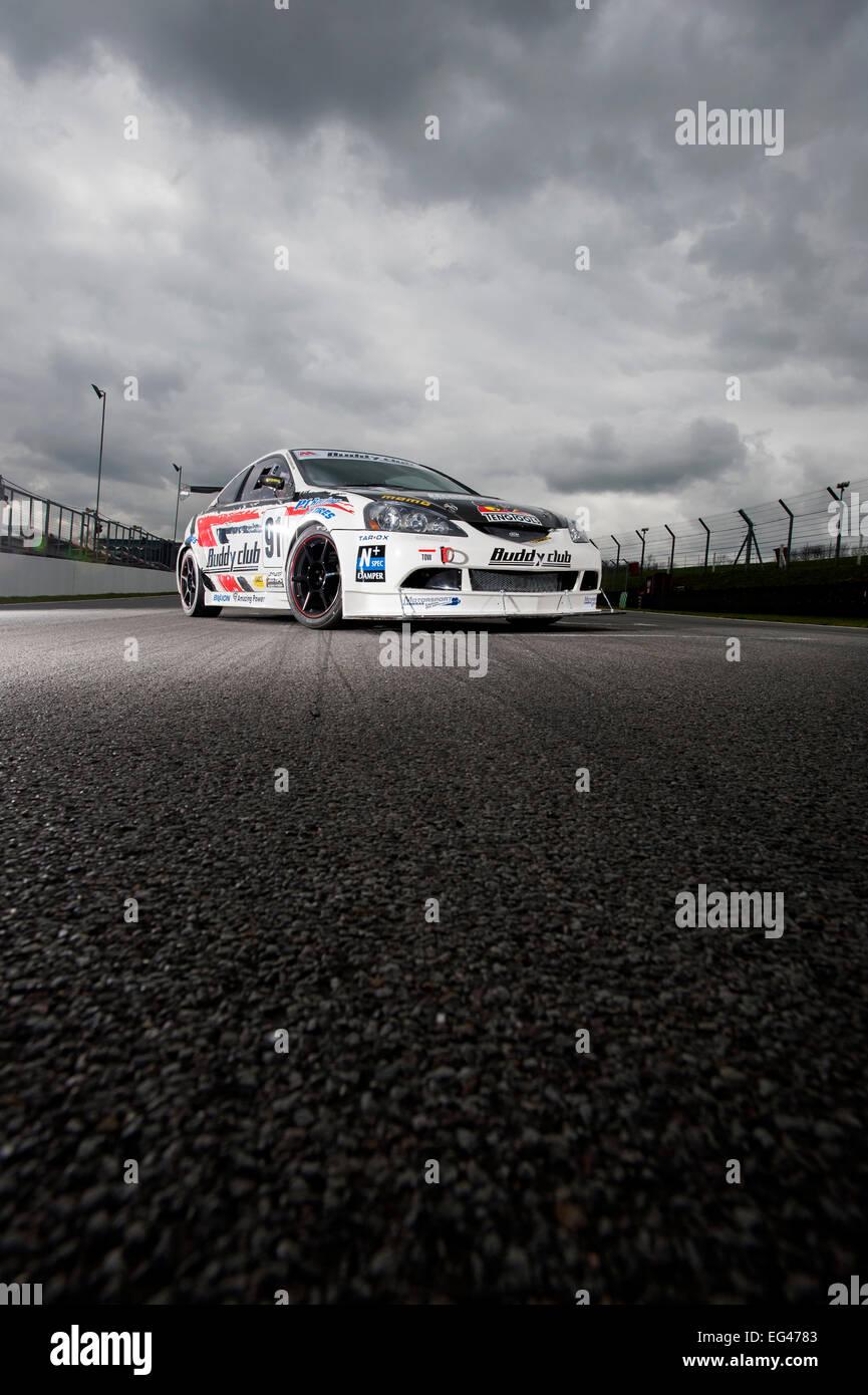 Honda Integra DC5 racing car on track at Brands Hatch circuit - Stock Image