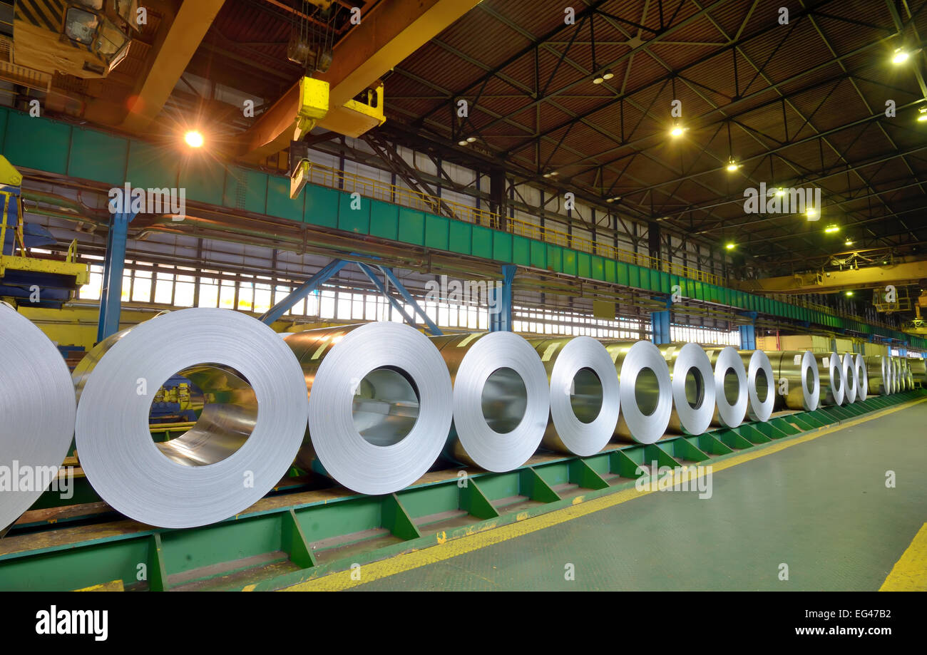 rolls of steel sheet in a plant, galvanized steel coil - Stock Image