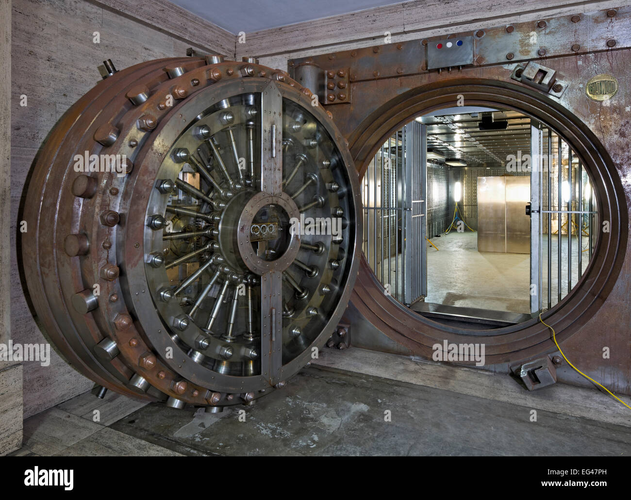 Huge bank vault door in a disused Bank - Stock Image