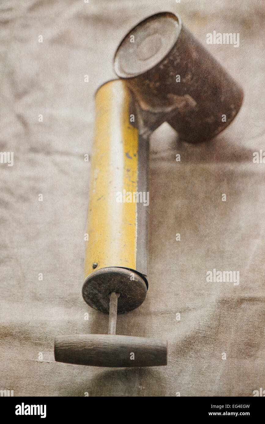 Old fashioned pump sprayer used with pesticide for killing bugs. - Stock Image