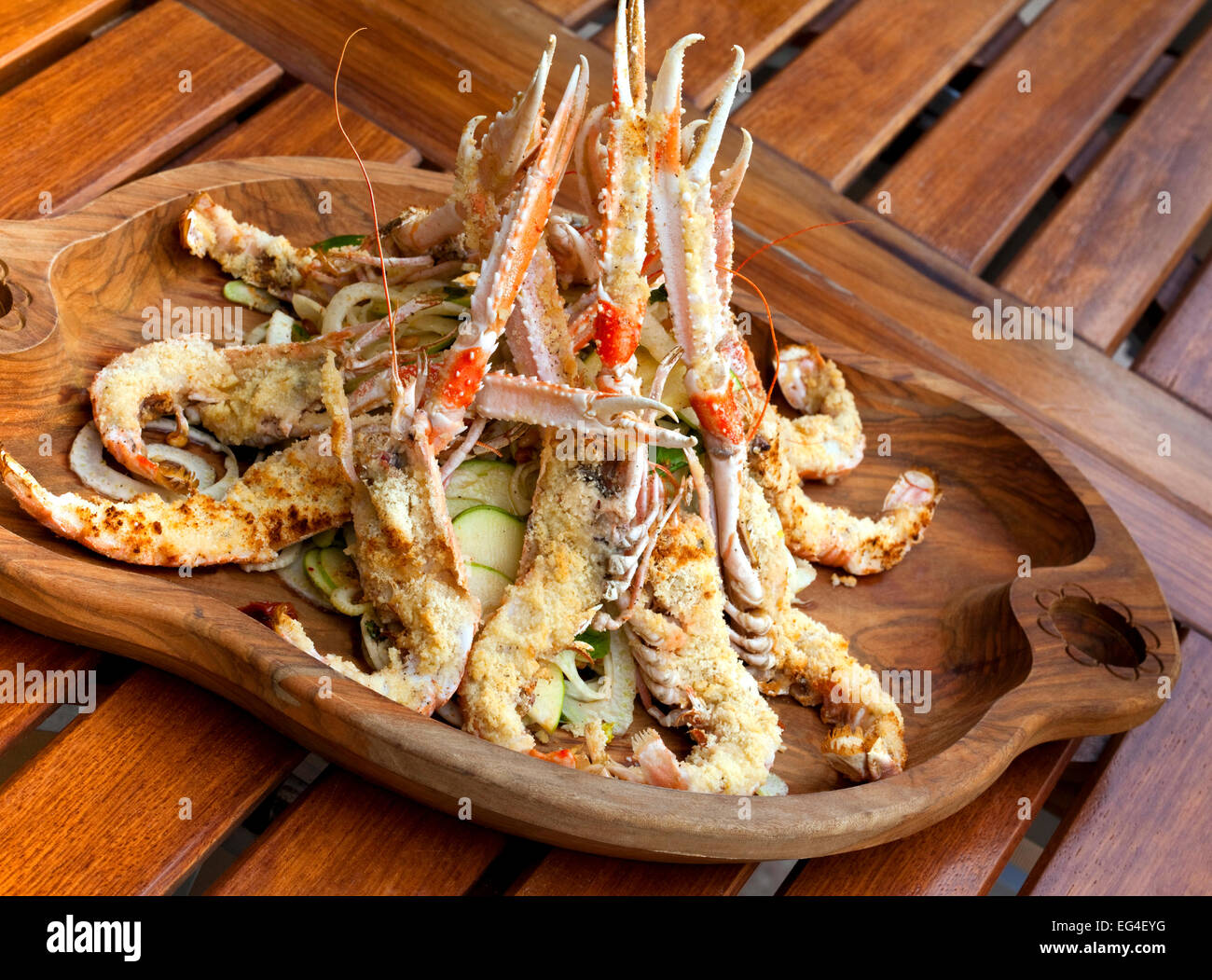 Breaded prawns and salad of raw vegetables - Stock Image