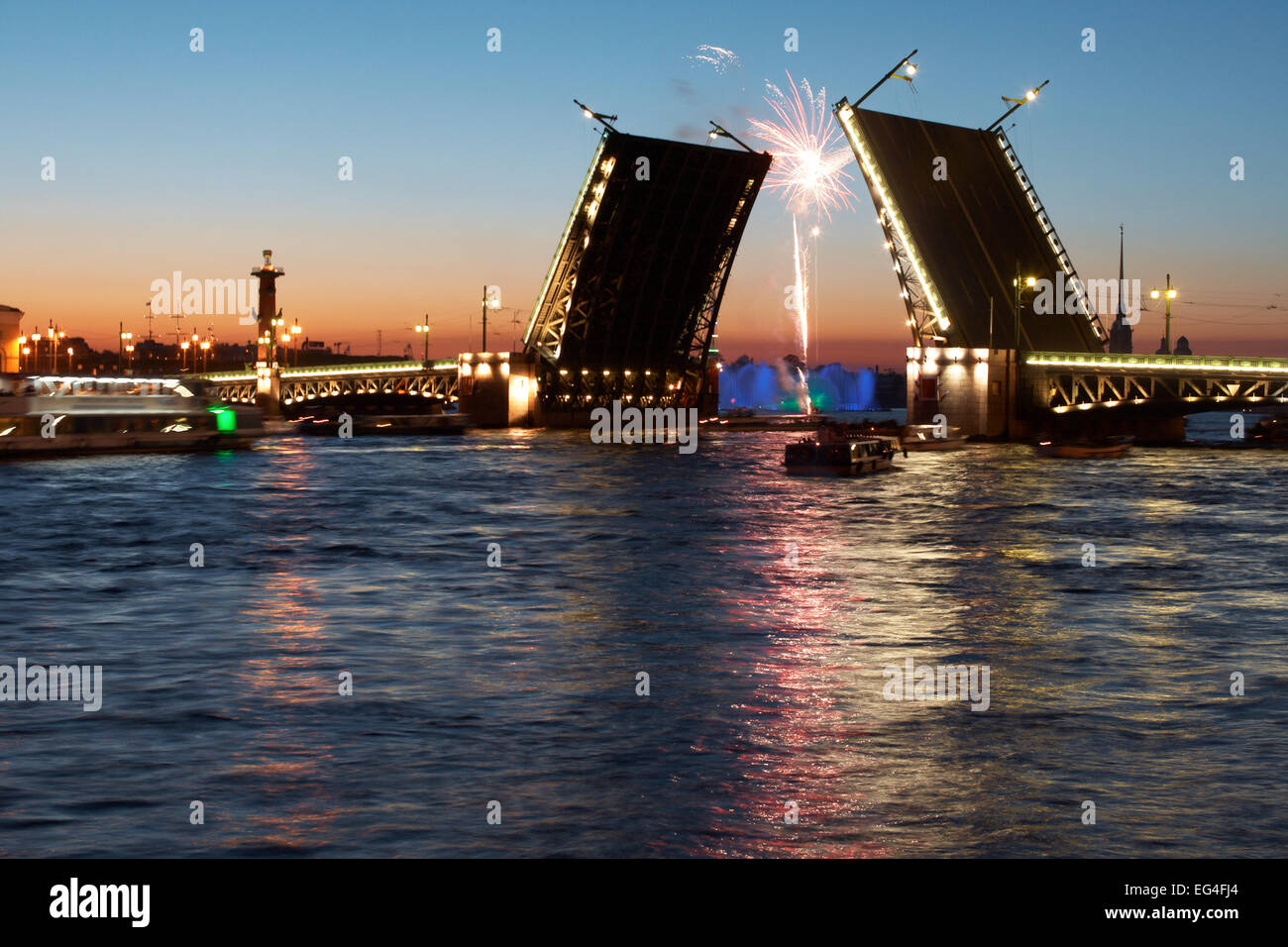 View of the Peter and Paul Fortress, water based fountain, firework  and open Stock Bridge at light night. Saint - Stock Image