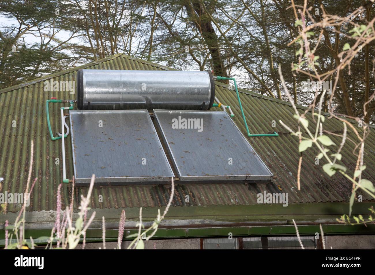 Solar thermal hot water system on roof of cottage Elsamere Kenya - Stock Image