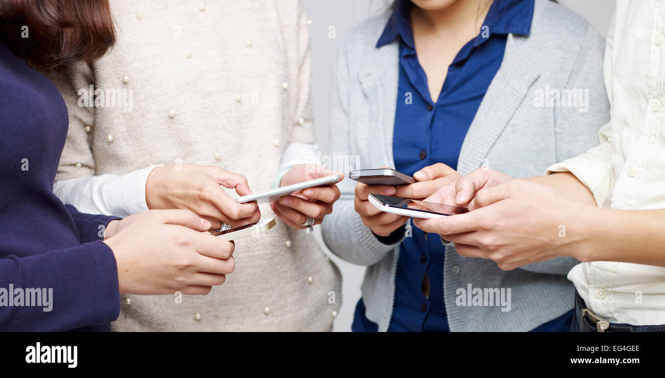 people using cellphones - Stock Image